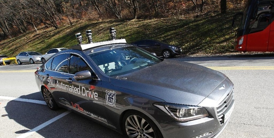 The driverless car called Snuber is test driven during a demonstration at the Seoul National University's campus in Seoul, South Korea, Tuesday, Nov. 15, 2016. Seoul National University professor Seo Seung-woo said that a self-driving car developed by his team will start roaming Seoul streets early next year thanks to a revised law that took effect Tuesday. (AP Photo/Ahn Young-joon)