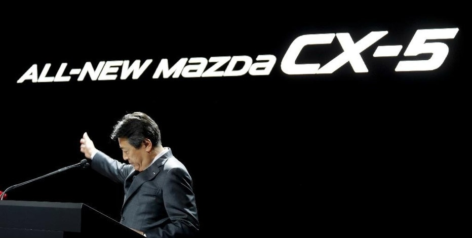 Akira Marumoto, executive vice president of Mazda, talks about the 2017 Mazda CX-5 during the Los Angeles Auto Show in Los Angeles, Wednesday, Nov. 16, 2016. (AP Photo/Chris Carlson)