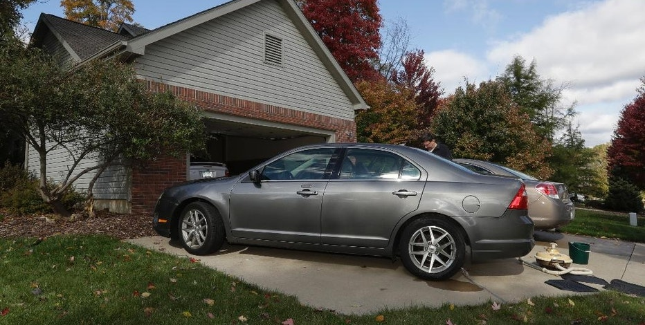 In a photo from Oct. 22, 2016, a 2010 Ford Fusion is parked in Saline, Mich. When shopping for a low-priced used car, three things will become evident: Some people want to swindle you. Few take proper care of their cars and the search will take a long time. (AP Photo/Carlos Osorio)