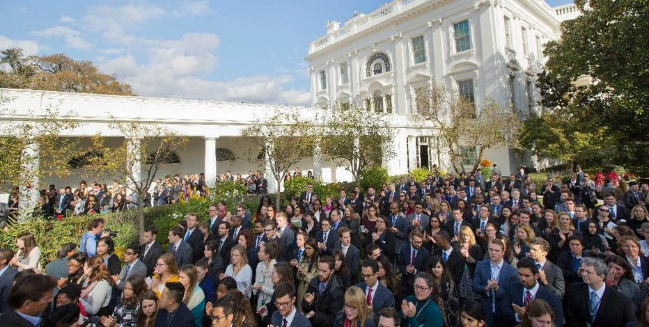 In this Nov. 9, 2016, photo, White House staff members applaud in the Rose Garden of the White House in Washington, after listening to President Barack Obama speak about the election. Hoping to ensure his staffers find decent jobs, Obama and his team have brought in representatives from Facebook, Instagram and others to offer insight into the job market, and officials from LinkedIn have come to the White House to help staffers identify ways to market their skills for their next positions. (AP Photo/Pablo Martinez Monsivais)
