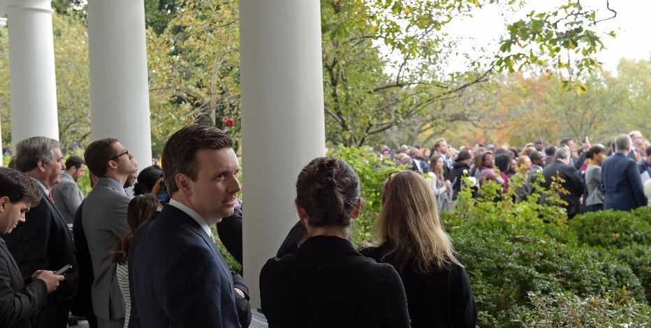 In this Nov. 9, 2016, photo, White House press secretary Josh Earnest waits for President Barack Obama to speak in the Rose Garden of the White House in Washington. Hoping to ensure his staffers find decent jobs, Obama and his team have brought in representatives from Facebook, Instagram and others to offer insight into the job market, and officials from LinkedIn have come to the White House to help staffers identify ways to market their skills for their next positions. (AP Photo/Susan Walsh)
