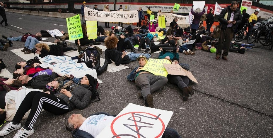 Protesters demonstrate in solidarity with members of the Standing Rock Sioux tribe in North Dakota over the construction of the Dakota Access oil pipeline, in Philadelphia, Tuesday, Nov. 15, 2016. (AP Photo/Matt Rourke)