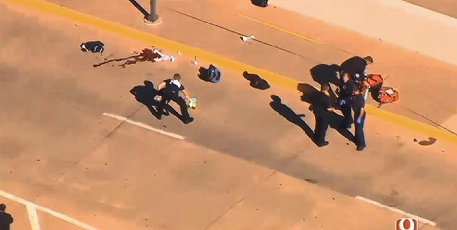 This still image taken from an aerial video provided by KWTV shows police responding to a shooting at Will Rogers World Airport in Oklahoma City, on Tuesday, Nov. 15, 2016.  Police say the airport has been closed following a shooting there.  Airport spokeswoman Karen Carney says all operations are suspended.  (KWTV via AP)