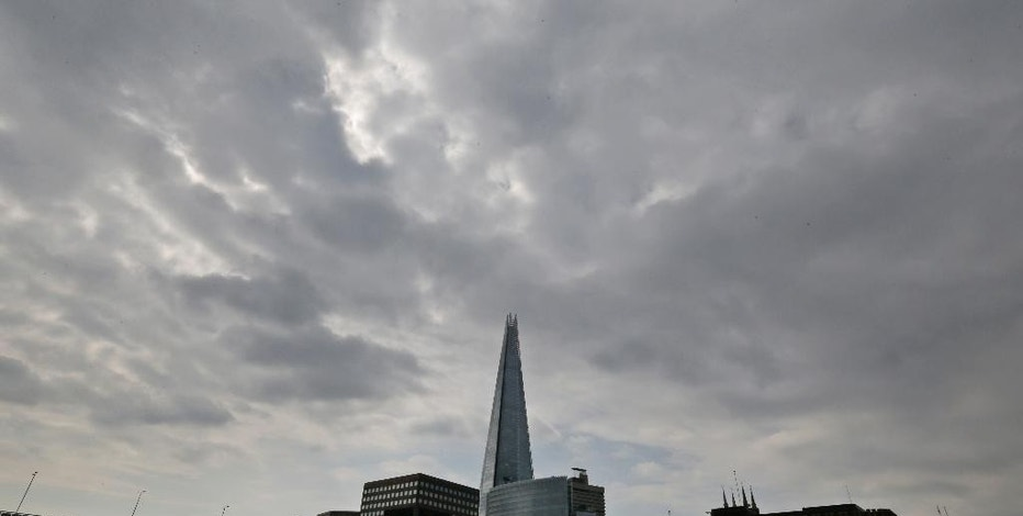 "FILE - In this Thursday, June 19, 2014 file photo, the Shard as seen from the river Thames in London. A new report says a drone just missed hitting an A320 passenger plane flying above the Shard skyscraper in central London in July. The ""very near-miss"" underscored the fears of many aviation experts about the growing popularity of drones. The plane was approaching Heathrow Airport and flying at nearly 5,000 feet (1,525 meters) when the pilot spotted a 50-centimeter (20-inch) drone off the right flight deck window, it was reported on Thursday, Nov. 17, 2016. (AP Photo/Lefteris Pitarakis, File)"