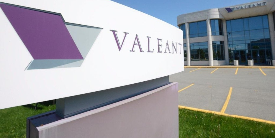 FILE - This May 27, 2013, file photo, shows the head office and logo of Valeant Pharmaceuticals in Laval, Quebec, Canada. Federal prosecutors have charged former executives of Valeant Pharmaceuticals and a mail-order pharmacy it helped establish, Philidor, with wire fraud and conspiracy in an alleged scheme to bilk Valeant out of tens of millions of dollars. The U.S. Attorney's office in Manhattan has filed the charges against ex-Valeant executive Gary Tanner and Andrew Davenport, who ran the now-defunct Philidor. (Ryan Remiorz/The Canadian Press via AP, File)