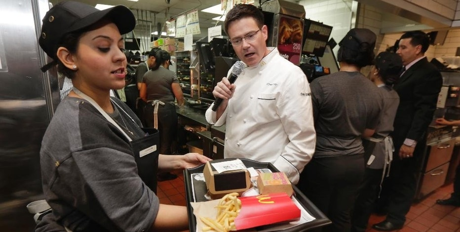 McDonald's Executive Chef Dan Coudreaut checks an outgoing order in the kitchen at a McDonald's restaurant, during a presentation in New York's Tribeca neighborhood, Thursday, Nov. 17, 2016. On Thursday, the company said it wants to makes its fast-food outlets feel more like restaurants, with plans to eventually expand table service across its U.S. locations. (AP Photo/Richard Drew)