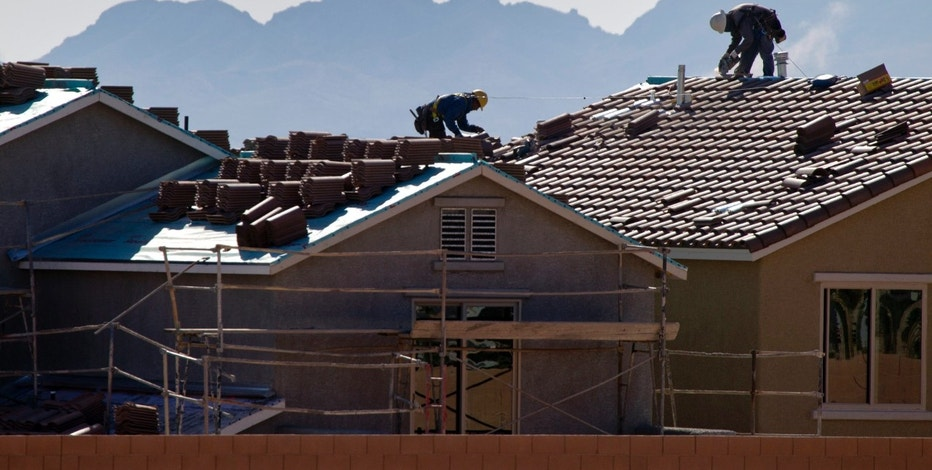 Roofers work on new homes at a residential construction site in the west side of the Las Vegas Valley in Las Vegas, Nevada April 5, 2013. The once-beleaguered Las Vegas housing market has been on fire since investment firms began buying homes here some eight months ago. Picture taken April 5, 2013. To match Special Report VEGAS-HOUSING/   REUTERS/Steve Marcus (UNITED STATES - Tags: REAL ESTATE BUSINESS CONSTRUCTION)