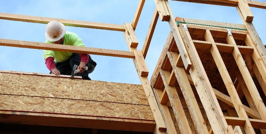 FILE - In this Jan. 12, 2015 photo, a builder works on a new apartment building under construction in Phoenix.  The government reports on home construction for October 2016 on Thursday, Nov. 17, 2016.   (AP Photo/Ross D. Franklin)