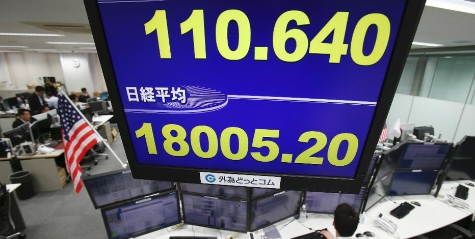 Money traders work at a foreign exchange brokerage in Tokyo, Friday, Nov. 18, 2016. Japanese shares rose Friday on the yen's weakness while other Asian benchmarks wobbled after Fed chair Janet Yellen signaled that policymakers plan to raise interest rates soon. (AP Photo/Koji Sasahara)