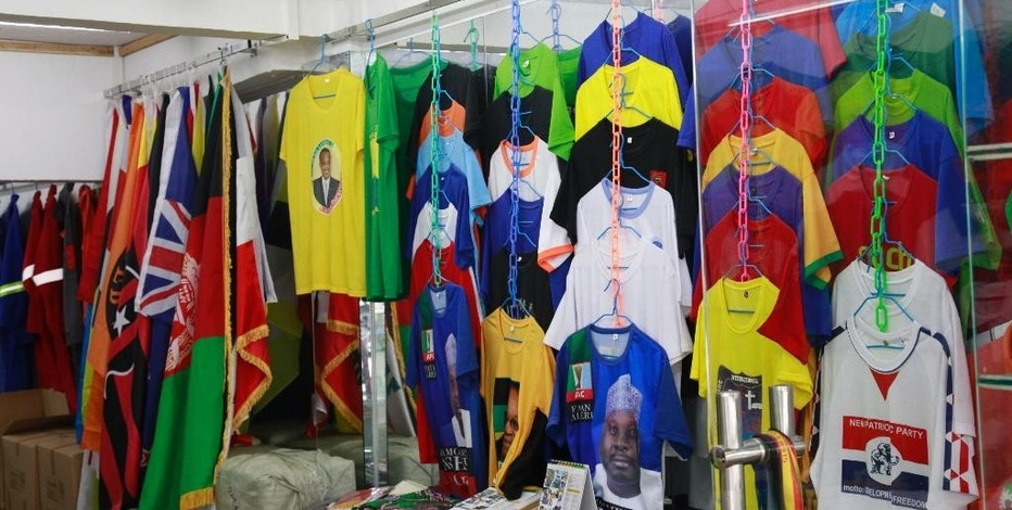 In this Thursday, Aug. 11, 2016, photo, a shop sells t-shirts catering to the local African communities in Guangzhou in southern China's Guangdong province. The largest African population in Asia is in decline because of a slowdown in the Chinese economy and increased competition from Chinese traders. (AP Photo/Louise Watt)