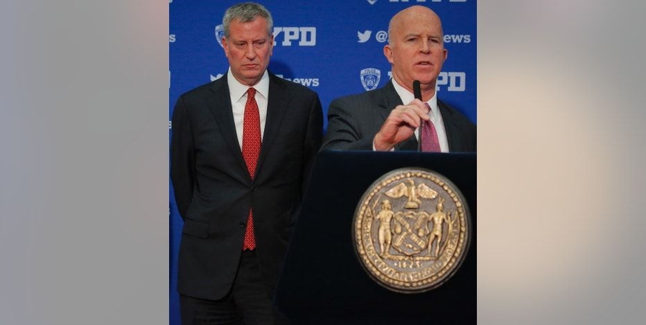Mayor Bill de Blasio, left, and NYPD Commissioner James O'Neill, right, hold a press conference discussing plans for new security and traffic restrictions around Donald Trump's headquarters at Trump Tower, Friday Nov. 18, 2016, in New York. (AP Photo/Bebeto Matthews)