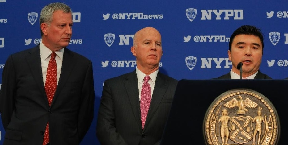 Mayor Bill de Blasio, left, NYPD Commissioner James O'Neill, center, and U.S. Secret Service Special Agent David Beach, right, hold a press conference discussing plans for new security and traffic restrictions around Donald Trump's headquarters at Trump Tower, Friday Nov. 18, 2016, in New York. (AP Photo/Bebeto Matthews)
