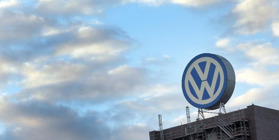 FILE - In this Sept. 26, 2015 file photo a giant logo of the German car manufacturer Volkswagen is pictured on top of a company's factory building in Wolfsburg, Germany. Volkswagen will announce its future strategy which might include job cuts in a press conference on Friday, Nov. 18, 2016. (AP Photo/Michael Sohn, file)