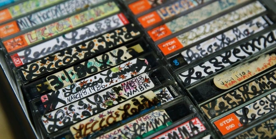 A collection of hip-hop cassette tapes from the 1980's are displayed at the Boston campus of the University of Massachusetts in Boston, Thursday, Nov. 17, 2016. Thanks to UMass, the world will soon have access to 300 unreleased demo tapes from the early days of Boston hip-hop. The university paired with Boston Public Library to form a new hip-hop archive that's the latest example of colleges treating hip-hop as a scholarly subject. (AP Photo/Charles Krupa)