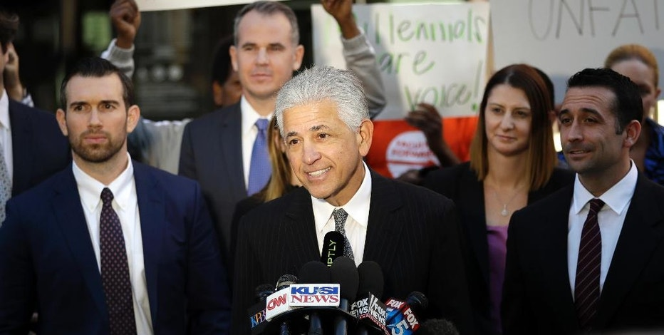 Daniel Petrocelli, lead attorney for President-elect Donald Trump, speaks after a hearing involving a lawsuit against the now-defunct Trump University Friday, Nov. 18, 2016, in San Diego. Trump agreed Friday to pay $25 million to settle several lawsuits alleging that his former business venture for real estate investors defrauded students who paid up to $35,000 to enroll in Trump University programs. (AP Photo/Gregory Bull)