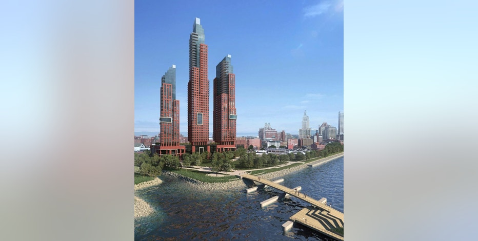 """This architectural rendering provided Thursday, Nov. 17, 2016, by The Fane Organization, shows a trio of luxury residential skyscrapers — the tallest at 55 stories — proposed to be built in downtown Providence, R.I. A New York developer who says he wants to transform the skyline of Rhode Island's capital city is meeting skepticism from some Providence leaders, including one who has jokingly coined the project the """"three towers of evil.""""  (Sol Wassermuhl /IBI Group via AP)"""