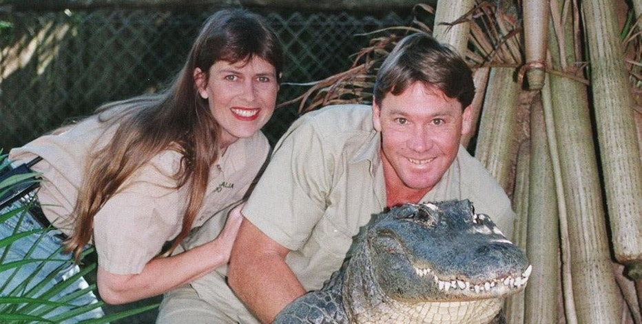 "FILE - In this June 18, 1999 file photo, Steve Irwin, ""The Crocodile Hunter"" holds a nine-foot female alligator accompanied by his American wife Terri at his ""Australia Zoo"" in Beerwah, Queensland, Australia. At least 35 people have been killed and many more injured since 2000 in accidents on productions outside the United States run by major studios, as well as regional companies. In 2006, Steve Irwin was killed by stingray in the waters off Australia while filming. (AP Photo/Russell McPhedran, File)"