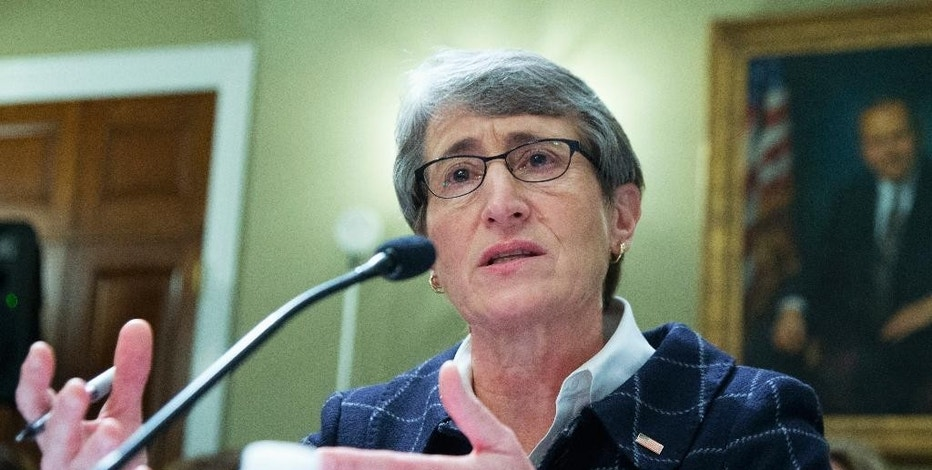 FILE- In this Dec. 9, 2015, file photo, Interior Secretary Sally Jewell testifies on Capitol Hill in Washington before the House Natural Resources Oversight Committee hearing on the Animas River Spill in Colorado. U.S. officials are blocking new mining claims outside Yellowstone National Park. Jewell was scheduled to be in Montana on Monday, Nov. 21, 2016, to announce that mining claims on 30,000 acres will be prohibited for two years while a long-term ban is considered. Details were obtained by The Associated Press in advance of Monday's formal announcement by Jewell. (AP Photo/Manuel Balce Ceneta, File)