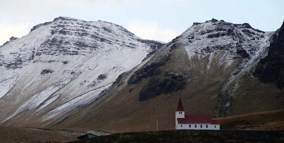 The church of Vik, Iceland, near the Volcano Katla, Wednesday, Oct. 26, 2016. Katla has helped turn sleepy Vik, a community of 300 people some 110 miles (180 kilometers) east of the capital, Reykjavik, into a tourism hotspot. (AP Photo/Frank Augstein)
