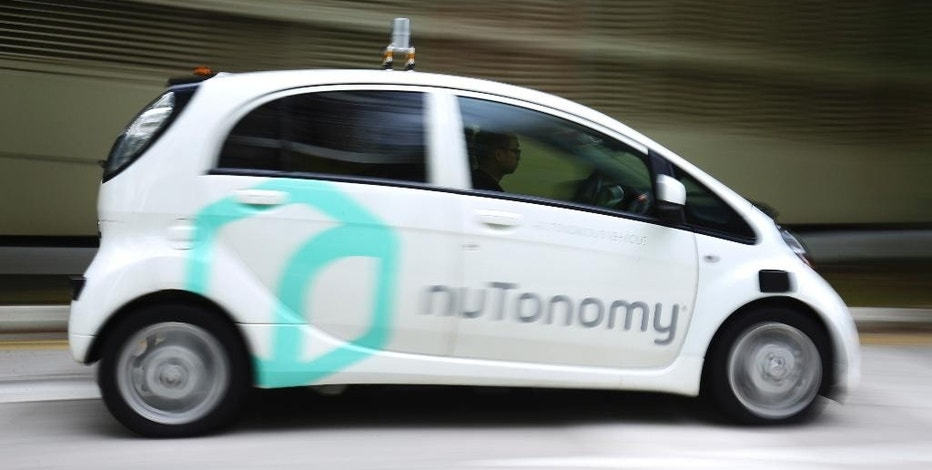 FILE - In this Wednesday, Aug. 24, 2016, file photo, an autonomous vehicle, operated by nuTonomy, is driven during its test drive in Singapore. Cambridge, Mass.-based NuTonomy, a startup that makes driverless vehicles, says it will start testing its self-driving cars on public streets in Boston by the end of 2016. (AP Photo/Yong Teck Lim, File)