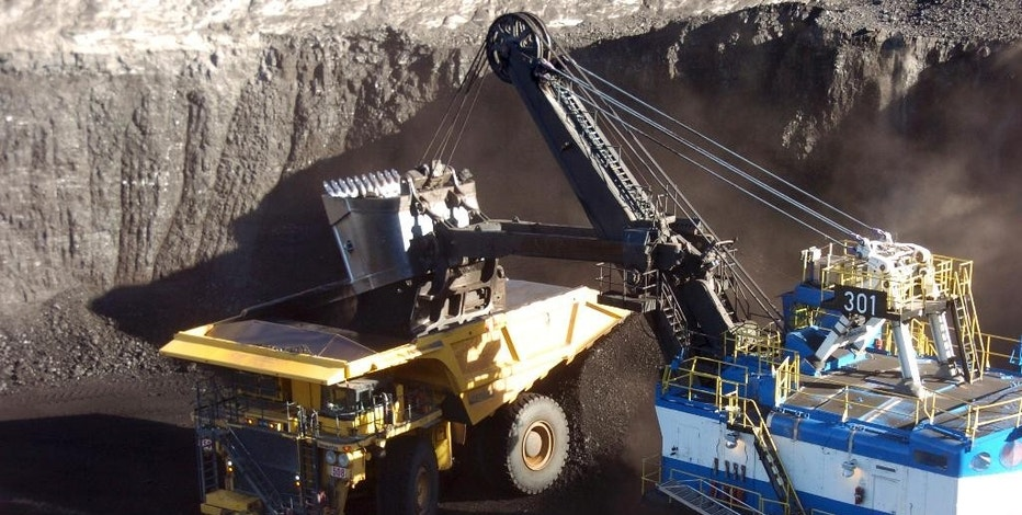 In this Nov. 15, 2016 photo, a mechanized shovel loads coal from an 80-feet thick seam into a haul truck at Cloud Peak Energy's Spring Creek mine near Decker, Mont. Coal from the mine is shipped to power plants for generating electricity. President-elect Donald Trump's vow to revive coal country is met with measured hope in Appalachia and even out West, where mines stand to gain the most. (AP Photo/Matthew Brown)