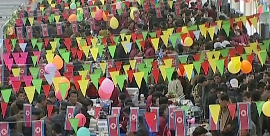 In this image made from March 13, 2004, video, people shop in Tongil Market in Pyongyang, North Korea. Hundreds of markets have emerged in North Korea since its public rationing systems fell apart in the mid-1990s. The growth of markets poses a potential threat to North Korea's strict control of its people but it still allows Kim Jong Un's government focus on bolstering its nuclear arsenal while letting his people feed themselves. (AP Photo)
