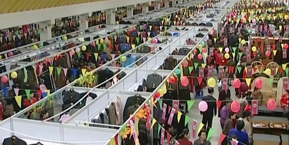 In this image made from March 13, 2004, video, people shop in the Tongil Market in Pyongyang, North Korea. Hundreds of markets have emerged in North Korea since its public rationing systems fell apart in the mid-1990s. The growth of markets poses a potential threat to North Korea's strict control of its people but it still allows Kim Jong Un's government focus on bolstering its nuclear arsenal while letting his people feed themselves. (AP Photo)