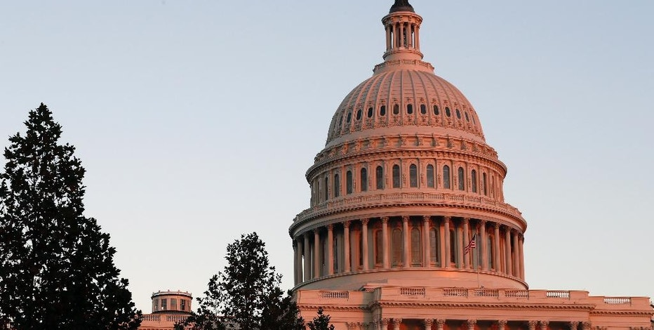 In this Nov. 18, 2016, photo, the U.S. Capitol dome is seen at sunset on Capitol Hill in Washington. President-elect Donald Trump promises big tax cuts, a border wall and massive spending on infrastructure. That's a recipe for bigger deficits that fiscal conservative Republicans have railed against during President Barack Obama's tenure. Trump's agenda runs counter to years of promises by congressional Republicans to try to balance the federal budget. (AP Photo/Alex Brandon)