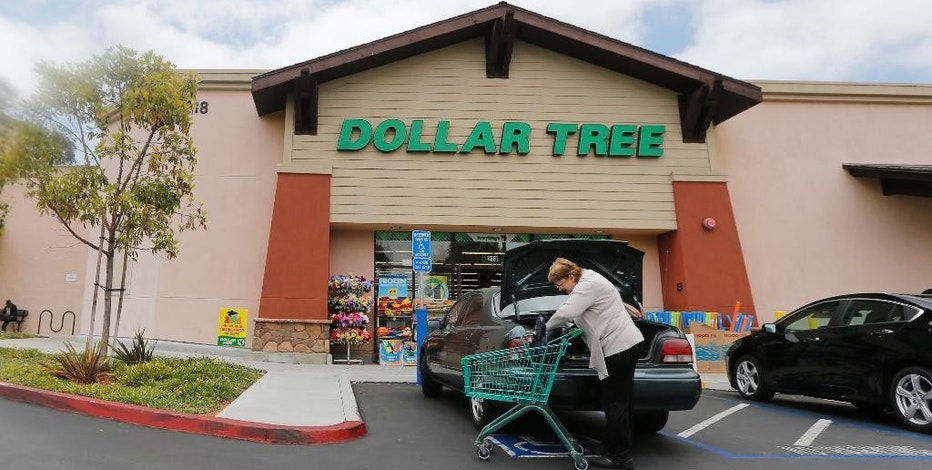 In this Thursday, May 26, 2016, photo, a shopper searches her purse outside a Dollar Tree store in Encinitas, Calif. Dollar Tree, Inc. reports earnings Tuesday, Nov. 22, 2016. (AP Photo/Lenny Ignelzi)