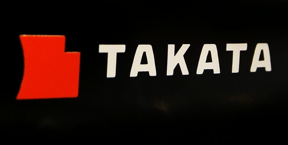 FILE - This July 6, 2016, file photo, shows the logo of Takata Corp. at an auto supply shop in Tokyo. U.S. safety regulators announced Monday, Nov. 21, 2016, they are allowing General Motors to delay a large recall of potentially defective air bags, giving GM time to prove the devices are safe and possibly avoid a huge financial hit. The unusual step allows for long-term tests of Takata air bag inflators in older trucks and SUVs. If GM proves the inflators are safe, the recall of 2.5 million trucks and SUVs could be canceled. (AP Photo/Shizuo Kambayashi, File)