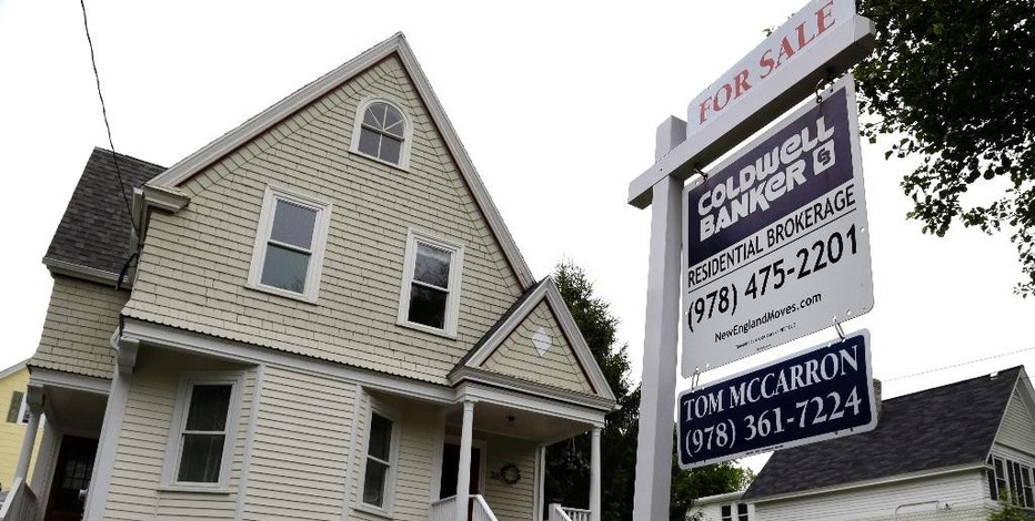 FILE - This Tuesday, May 24, 2016, file photo shows a home for sale in Andover, Mass. On Tuesday, Nov. 22, 2016, the National Association of Realtors reports on October sales of existing homes. (AP Photo/Elise Amendola, File)
