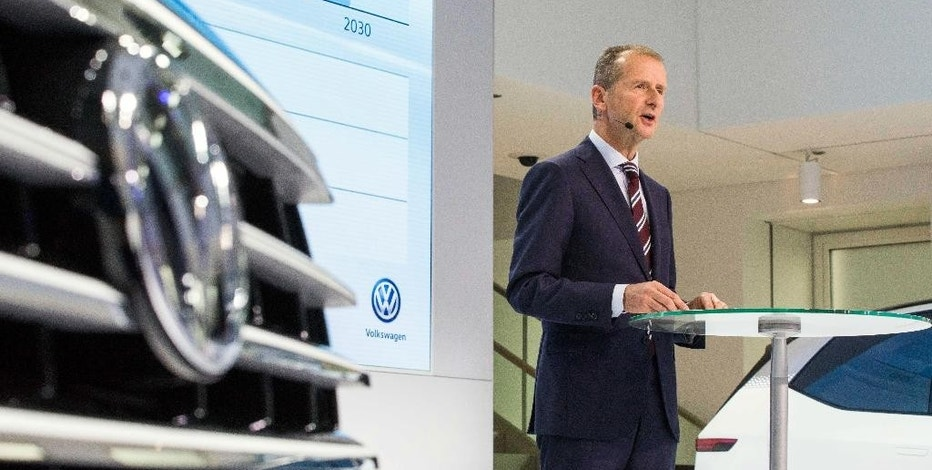 "The head of Volkswagen core brand  Herbert Diess speaks at a news conference at the Volkswagen headquarters in Wolfsburg, northern Germany, Tuesday Nov. 22, 2016. Volkswagen division head Herbert Diess said  that the goal is ""to fundamentally change Volkswagen"" as it bounces back from a scandal over cars rigged to cheat on diesel emissions tests. The plan foresees new investments in electric-car technology and in software that would enable new ways of using and sharing cars over the longer term.   ( Philipp von Ditfurth/dpa via AP)"