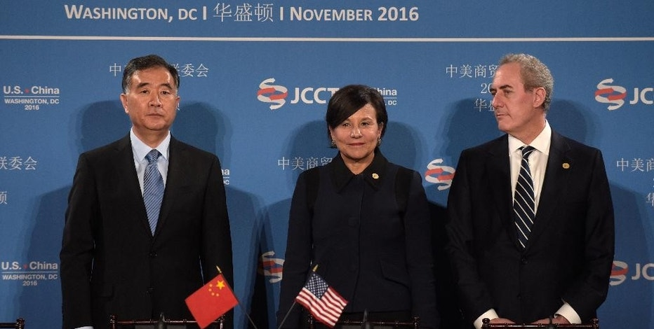 Commerce Secretary Penny Pritzker, center, stands with Chinese Vice Premier of the State Council Wang Yang, left, and U.S. Trade Representative Ambassador Michael Froman, before the start of a signing ceremony at the 27th session of the U.S.-China Joint Commission on Commerce and Trade in Washington, Wednesday, Nov. 23, 2016. (AP Photo/Susan Walsh)