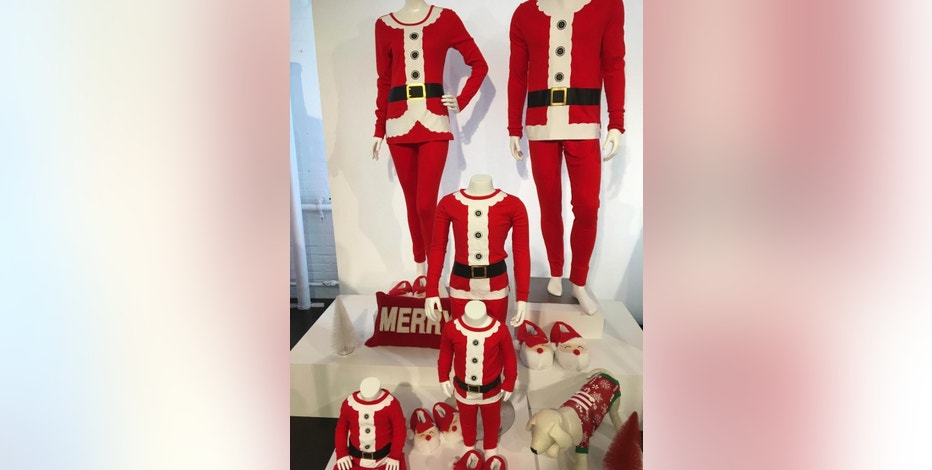 This Oct. 25, 2016, photo, shows a display of Santa pajama sets on display at Target's company studio in New York. Analysts say that whimsical items like the Santa pajama sets should resonate well for shoppers looking for some relief in a divisive political environment. (AP Photo/Anne D'Innocenzio)
