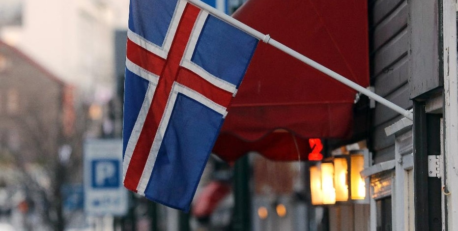 "FILE - In this Thursday, Oct. 27, 2016 file photo, an Icelandic flag hangs outside a shop in Reykjavik. The island nation of Iceland says it is taking legal action against British frozen-food chain Iceland over the right to use their shared name. Iceland's Ministry of Foreign Affairs says it has challenged Iceland Foods at the European Union Intellectual Property Office. It says it is acting because the retail chain ""aggressively pursued"" Icelandic companies using the word Iceland in their branding. In a statement on Thursday, Nov. 24 it says the situation has left the country's firms ""unable to describe their products as Icelandic."" (AP Photo/Frank Augstein, file)"