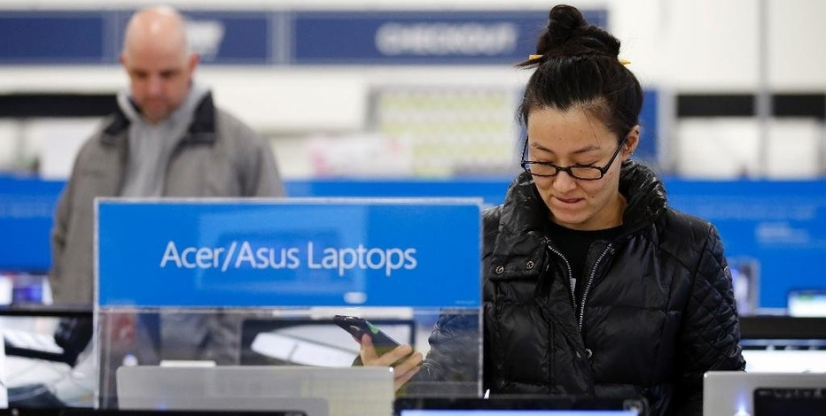 Shoppers browse items at a Best Buy store on Friday, Nov. 25, 2016, in Skokie, Ill. Shoppers were on the hunt for deals and were at the stores for entertainment Friday as malls opened for what is still one of the busiest days of the year, even as the start of the holiday season edges ever earlier.  (AP Photo/Nam Y. Huh)
