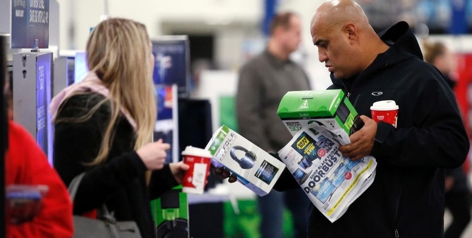 Shoppers browse items at a Best Buy store on Friday, Nov. 25, 2016, in Skokie, Ill. Black Friday, historically the starting line of the retail industry's crucial holiday buying season, isn't quite the one-day spree it used to be. Some retailers have pushed their biggest Black Friday door-buster deals into Thanksgiving Day and spread other promotions to even earlier in the season. (AP Photo/Nam Y. Huh)