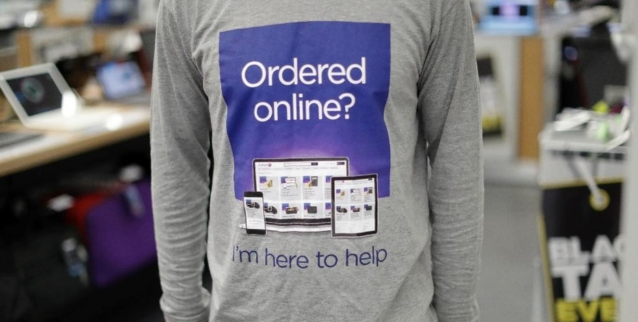 A store employee wears a shirt to help customers collect their Black Friday online sales purchases from a branch of electrical a retailer on Oxford Street in London, Friday, Nov. 25, 2016. Many Black Friday discount purchases were being carried out online in 2016, as bargain hunters made a technological shift from the traditional early morning queues waiting for retail outlets to open their doors. (AP Photo/Matt Dunham)