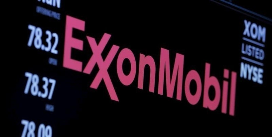 The logo of Exxon Mobil Corporation is shown on a monitor above the floor of the New York Stock Exchange in New York, New York, U.S. December 30, 2015.  REUTERS/Lucas Jackson/File Photo