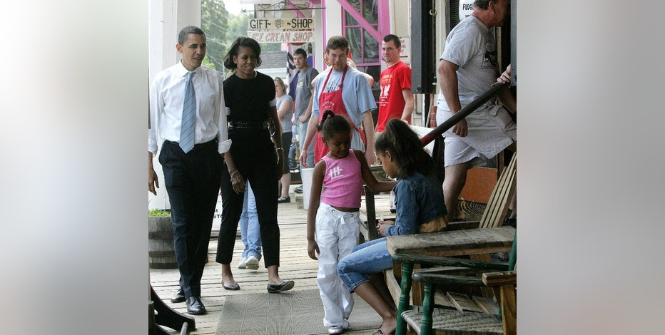 FILE - In this May 28, 2007, file photo Democratic presidential hopeful, U.S. Sen., Barack Obama, left, with his wife Michelle and his daughters Sasha, left, Malia, stop by The Brick Store general store for lunch while campaigning in Bath, N.H. The new owners of the closed historic general store in New Hampshire are gearing up for its grand reopening. The Brick Store was built more than 200 years ago and until this year, had been continuously operating as a general store. (AP Photo/Jim Cole, File)