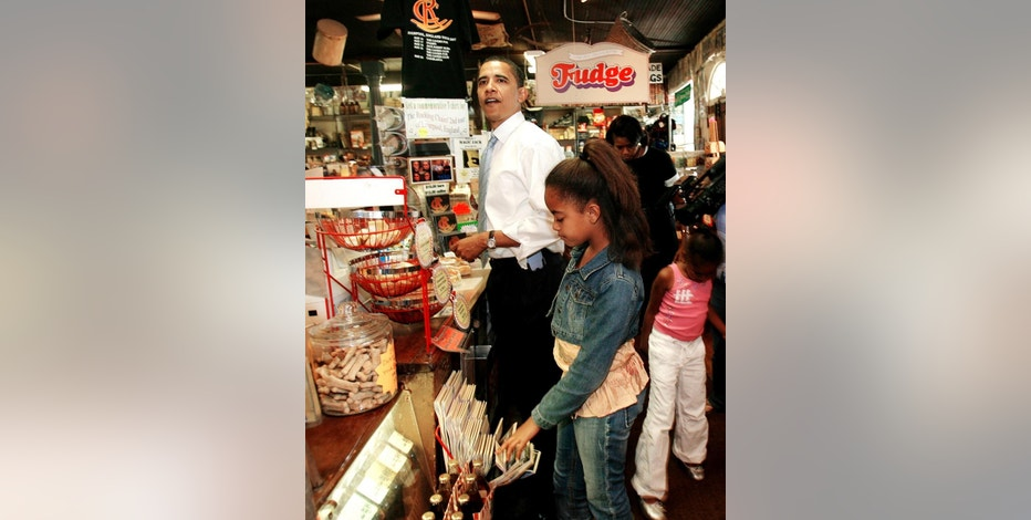 FILE -  In this May 28, 2007, file photo Democratic presidential hopeful, U.S. Sen., Barack Obama and his daughters Malia, front and Sasha stop by The Brick Store for lunch while campaigning in Bath, N.H. The new owners of the closed historic general store in New Hampshire are gearing up for its grand reopening. The Brick Store was built more than 200 years ago and until this year, had been continuously operating as a general store. (AP Photo/Jim Cole, File)