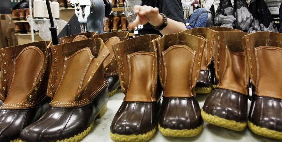FILE - In this Dec. 14, 2011, file photo, Eric Rego stitches boots in the facility where LL Bean boots are assembled in Brunswick, Maine. L.L. Bean is kicking it up a notch as demand continues to surge for its iconic boot. The Maine-based outdoors retailer has leased a 110,000-square-foot building and plans to install a third injection-molding machine. The company is boosting production to meet demand that's expected to reach 1 million pairs in 2018. (AP Photo/Pat Wellenbach, File)
