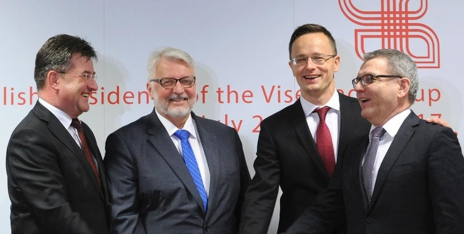 Foreign Ministers of the Visegrad group countries, from left, Slovakia's Miroslav Lajcak, Poland's Witold Waszczykowski, Hungary's Peter Szijjarto and Czech Republic's Lubomir Zaoralek pose for a photo prior to their talks with Federica Mogherini, the High Representative of the European Union for Foreign Affairs and Security Policy, in Warsaw, Poland, Tuesday, Nov. 29, 2016. (AP Photo/Alik Keplicz)