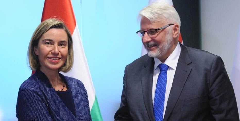 Federica Mogherini, the High Representative of the European Union for Foreign Affairs,  and Security Policy, left,  shakes hands with Poland's Foreign Minister Witold Waszczykowski, right, prior to a meeting with foreign ministers of Central and South-Eastern European countries, in Warsaw, Poland, Tuesday, Nov. 29, 2016. (AP Photo/Alik Keplicz)