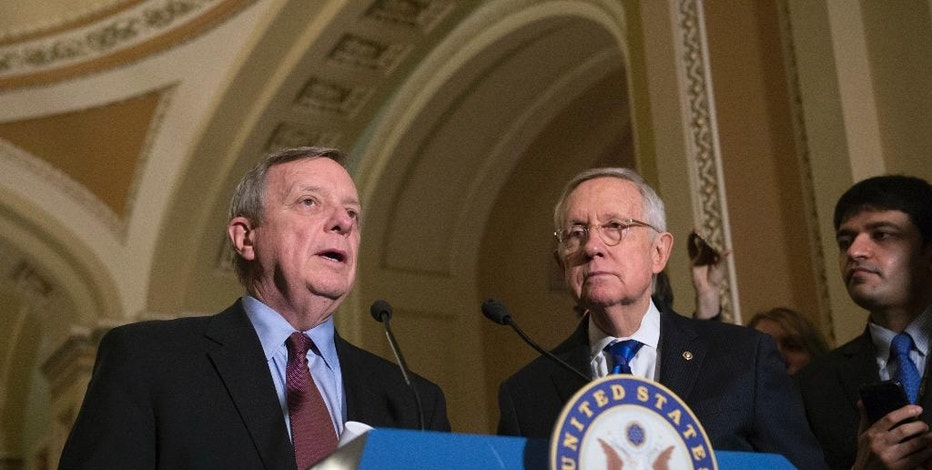 Minority Whip Richard Durbin, D-Ill., speaks to the media with Senate Minority Leader Harry Reid, D-Nev., after the Senate Policy Luncheon on Capitol Hill, Tuesday, Nov. 29, 2016 in Washington. (AP Photo/Molly Riley)