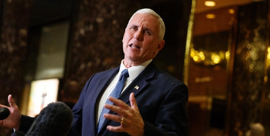 Vice President-elect Mike Pence talks with reporters in the lobby of Trump Tower, Tuesday, Nov. 29, 2016, in New York. (AP Photo/Evan Vucci)