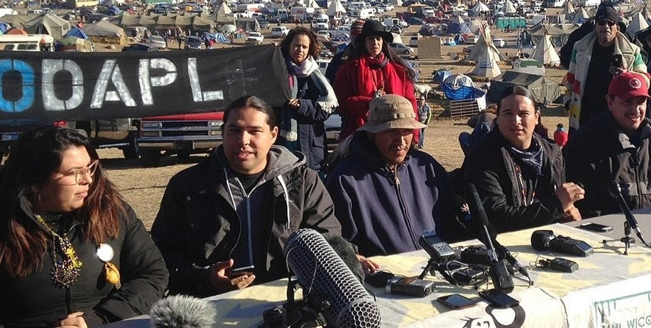 FILE - In this Saturday, Nov. 26, 2016 file photo, organizers of protests against construction of the Dakota Access oil pipeline speak at a news conference near Cannon Ball, N.D. Government orders for protesters of the Dakota Access pipeline to leave federal land could have little immediate effect on the encampment where scores of people have been gathered for months to oppose the $3.8 billion project. A North Dakota sheriff on Monday, Nov. 28, 2016, dismissed a deadline from the Army Corps of Engineers as a meaningless move aimed only at reducing the government's legal responsibility for hundreds of demonstrators. (AP Photo/James MacPherson, File)