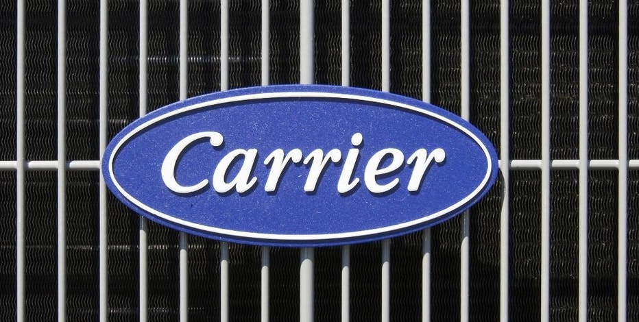 FILE - This April 21, 2009, file photo shows the Carrier logo on an air conditioning unit in Omaha, Neb. Carrier and President-elect Donald Trump reached an agreement to keep nearly 1,000 jobs in Indiana. Trump and Vice President-elect Mike Pence planned to travel to Indiana on Thursday, Dec. 1, 2016, to unveil the agreement alongside company officials. (AP Photo/Nati Harnik, File)