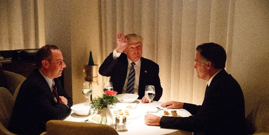 President-elect Donald Trump, center, eats dinner with Mitt Romney, right, and Trump Chief of Staff Reince Priebus at Jean-Georges restaurant, Tuesday, Nov. 29, 2016, in New York. (AP Photo/Evan Vucci)