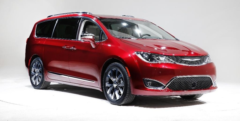 FILE - This Friday, Jan. 8, 2016, file photo, shows the 2017 Chrysler Pacifica, in Auburn Hills, Mich. Fiat Chrysler says its new gas-electric hybrid minivan will get the equivalent of 84 miles per gallon in electric mode and 32 mpg in city-highway mileage when in hybrid mode. The redesigned Chrysler Pacifica minivan went on sale earlier in 2016, and the hybrid version is due in showrooms in December. (AP Photo/Paul Sancya, File)